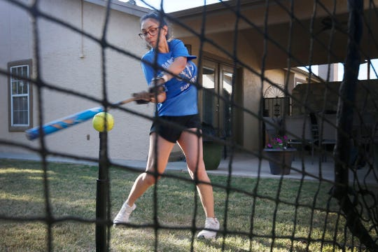 Samantha Chavez practices hitting in her backyard Tuesday, April 14, in El Paso. Samantha is a softball player at Montwood High School and is going to play at Sul Ross State University in college.