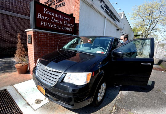 Anthony Guarino Jr. of Yanantuono Burr Davis Sharpe Funeral Home in Mount Vernon leaves the funeral home to pick up a body at a local hospital on April 15, 2020. He said his funeral home has handled 35 arrangements over the past 2 weeks, when typically, they'd do 12 to 18 per month.