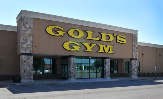 Signs posted at the entrance of the Wichita Falls Gold's Gym notify its members that the gym is temporarily closed due to the COVID-19 outbreak. Gold's Gym announced on their social network sites, that they would be permanently closing 30 of their company-owned gym locations.