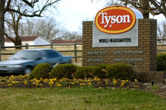A car passes in front of a Tyson Foods Inc., sign at Tyson headquarters in Springdale, Ark.