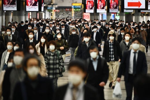 People commute to work despite a state of emergency in Japan at Shinagawa station in Tokyo on April 16, 2020.