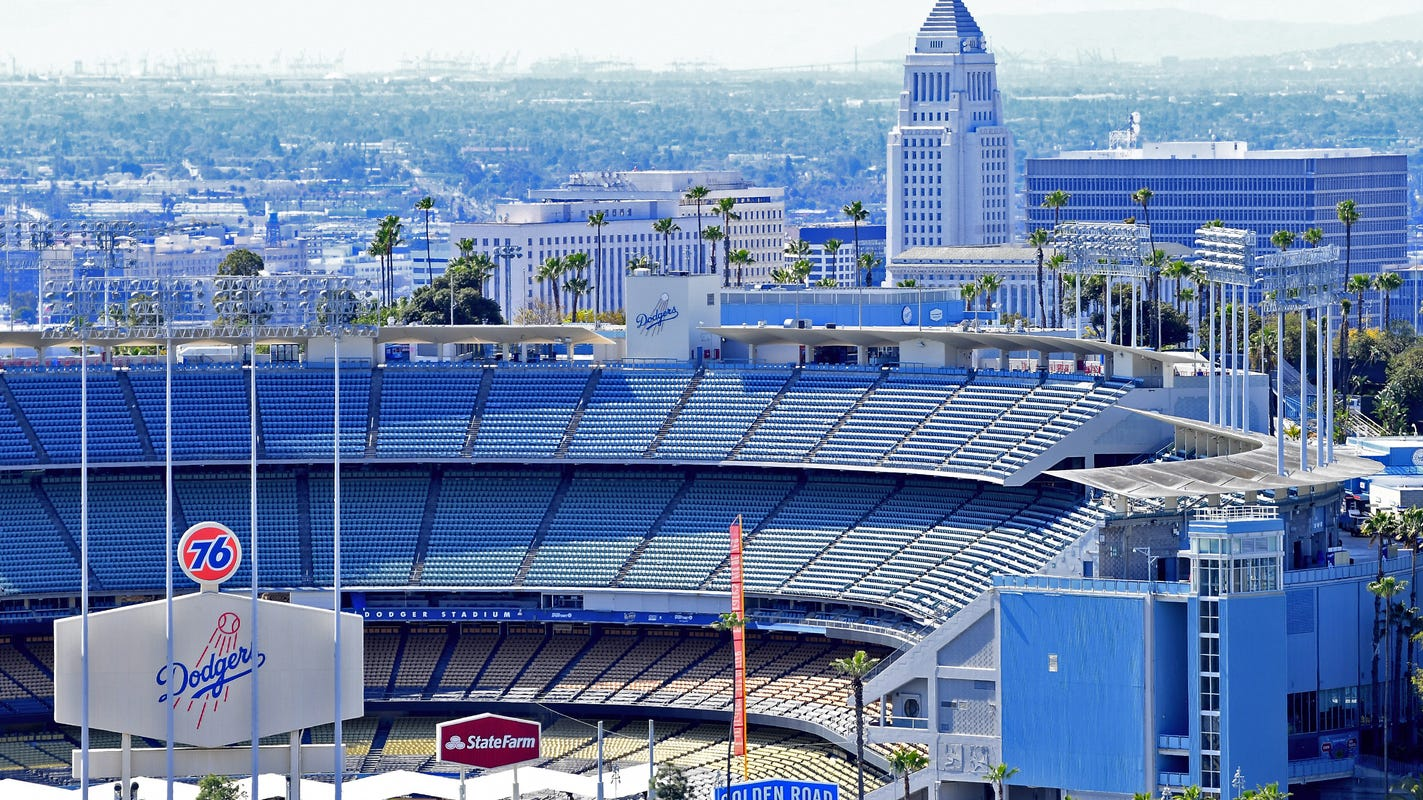 Los Angeles mayor Eric Garcetti says large gatherings, such as sporting events,...
