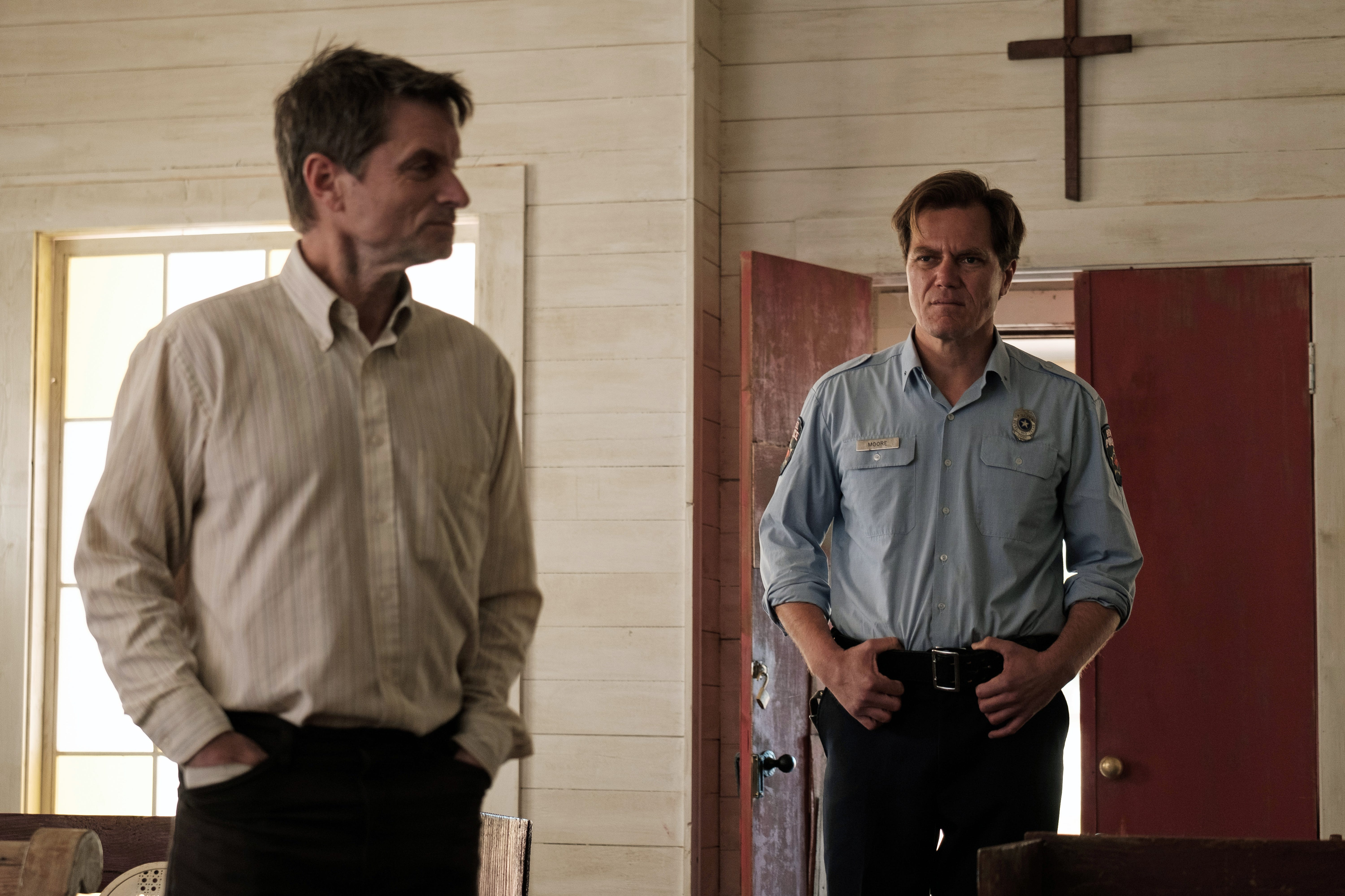 "Shea Whigham (left) stars as a mysterious new preacher and Michael Shannon is a suspicious Texas police chief in ""The Quarry."""