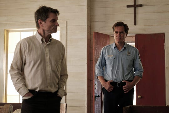 """Shea Whigham (left) stars as a mysterious new preacher and Michael Shannon is a suspicious Texas police chief in """"The Quarry."""""""
