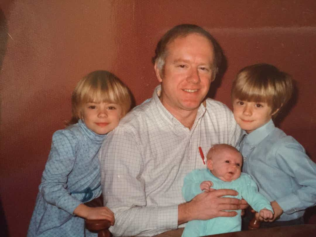 Donald Adair with three of his kids, from left, Abby Adair Reinhard, Carrie Boulus, and Tom Adair in a 1985 photo