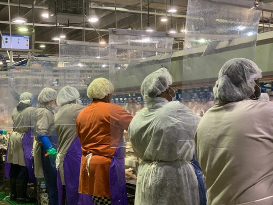 Workers are separated by sheeting at a Tyson Foods plant in Camilla, Georgia.
