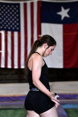 Kaydi Pursley settles her grip and focuses her mind before making a run for the pole vaulting pit inside her grandfather's grain warehouse Wednesday.