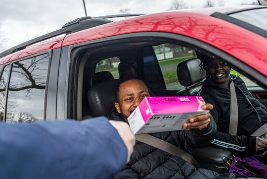 The Battle Creek nonprofit, R.I.S.E., distributes food during economic hardship brought upon by the COVID-19 pandemic on Friday, April 10, 2020 at Washington Heights Methodist Church.