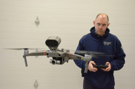 Corporal Andrew Olsen test flies a new drone Friday at the Battle Creek Police Department.  Trace Christenson/The Enquirer