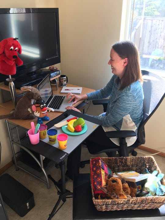 Holly Ridge Center speech-language pathologist Molly Perri at her home desk. Perri and other Holly Ridge educators have been forced to connect with families remotely during the COVID-19 outbreak.