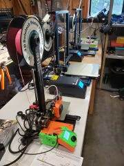 Some of Joey Sim's printers in Gig Harbor. The engineer at Keyport has become the Kitsap COVID-19 PPE Maker Team's treasurer, and its GoFundMe campaign has raised more than $15,000.