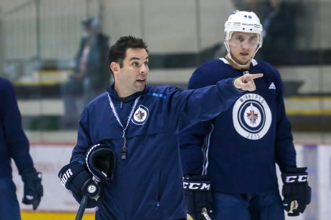 Todd Woodcroft instructs players during a Winnipeg Jets practice.