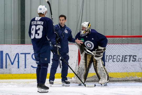 Todd Woodcroft instructs during a Winnipeg Jets practice.