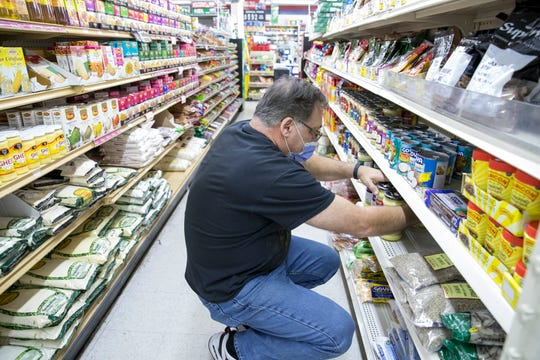 Mitchell Hamauei, owner of the Middle East Market & Deli, said he has seen a lot of new faces since the start of the coronavirus pandemic. Some people are curious about what they sell and some are trying new foods.