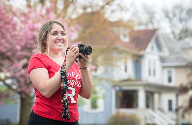 """Rutgers-New Brunswick senior Meghan O'Neill of Collingswood  photographed portraits of community members in front of their homes during the COVID-19 shutdown for her project entitled """"Struggle on the Homefront"""".  O'Neill collected over 500 dollars in donations from the project to help families in need."""