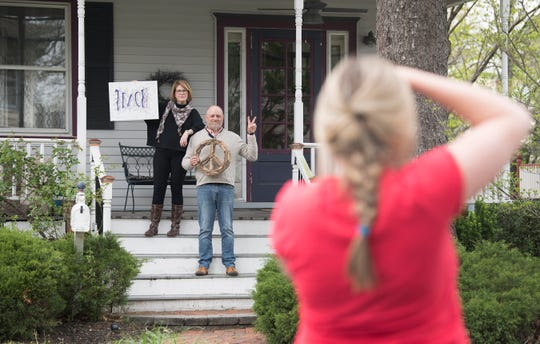 """Rutgers-New Brunswick senior Meghan O'Neill of Collingswood photographs Susan and Scott Myers in front of their Collingswood home during the COVID-19 shutdown for O'Neill's portrait project entitled """"Struggle on the Homefront"""",   O'Neill collected over 500 dollars in donations from the project to help families in need."""