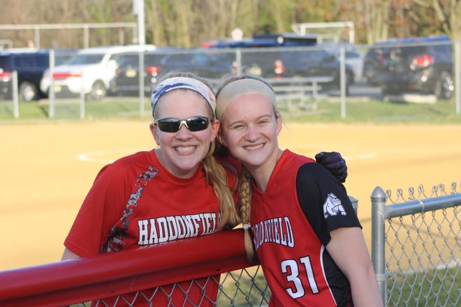 Haddonfield's Abby Mackey (right) poses with her younger sister, Courtenay, after a game last season. Abby is a captain for the Haddons softball team this spring.