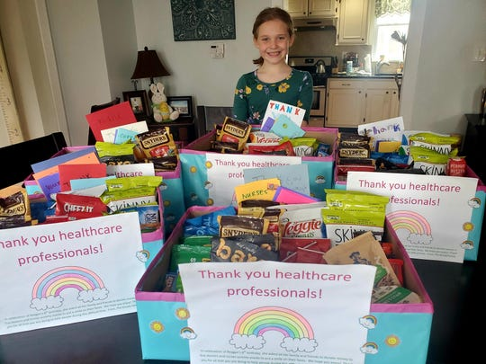 Reagan Goudy, 8, prepared boxes of snacks for area hospitals and for the Audubon Police Department.