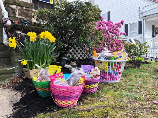 """Rutgers-New Brunswick senior Meghan O'Neill of Collingswood used the money raised fromher photo project entitled """"Struggle on the Homefront""""  to surprise two families with a supply of groceries and Easter baskets, and will be surprising two more families with gift cards that can be used to make much needed purchases."""