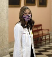 Dr. Amy Acton, director of the Ohio Department of Health, leaves the State Room at the Statehouse after the daily briefing on the coronavirus pandemic.