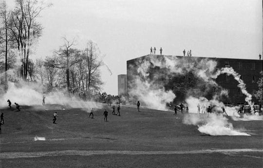 Plumes of tear gas drift across the Commons area near Johnson Hall on May 4, 1970, before four Kent State students were shot and killed by the Ohio National Guard. Nine more students were wounded. [DON ROESE/AKRON BEACON JOURNAL]