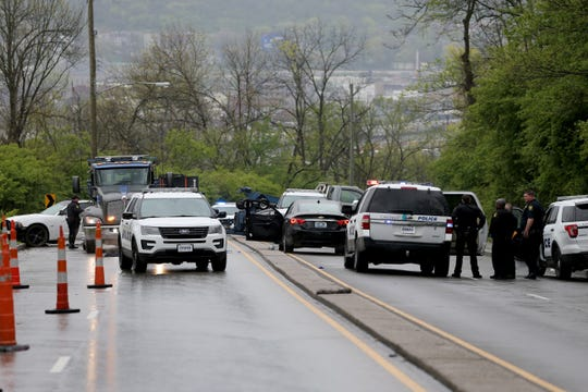 Authorities respond to a crash in the 1900 block of Westwood Northern Boulevard, Friday, April 17, 2020, in Cincinnati. A victim from an unrelated shooting alerted an officer responding to the crash and was taken to University of Cincinnati Medical Center.