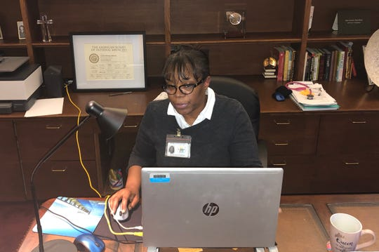 For the time being, at least, Dr. Latisha Malcolm is seeing patients virtually at her home office.