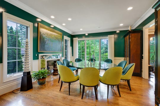 With striking furniture and vivid colors, the formal dining room becomes the exclamation point of the house. The owners switched the living and dining rooms to get this large, dramatic space.