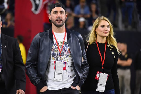 Justin Verlander, left, and his wife Kate Upton