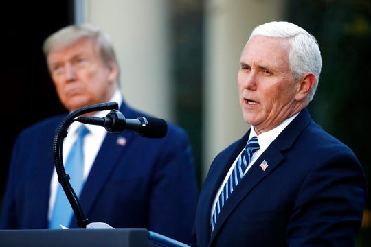"""President Donald Trump listens as Vice President Mike Pence speaks about the coronavirus in the Rose Garden of the White House, Wednesday, April 15, 2020. Asked on Fox Business Network about whether China might have manipulated the virus for sinister purposes, Pence said, """"It is completely appropriate that the world ask the right questions,"""" then diverted to another subject."""
