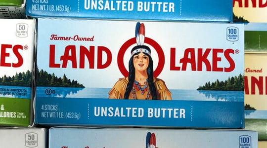 Packages of Land O' Lakes butter are shown at a grocery store in this Nov. 12, 2019, file photo. The Native American woman who has graced the packaging of Land O'Lakes butter, cheese and other products since the late 1920s has quietly disappeared.