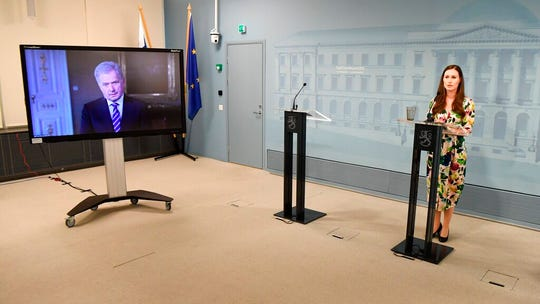 Finland Prime Minister Sanna Marin, with President of Finland Sauli Niinist', via video link, as they attend an event to  give information about the Finnish national policy to deal with the COVID-19 coronavirus, in Helsinki Friday April 17, 2020.