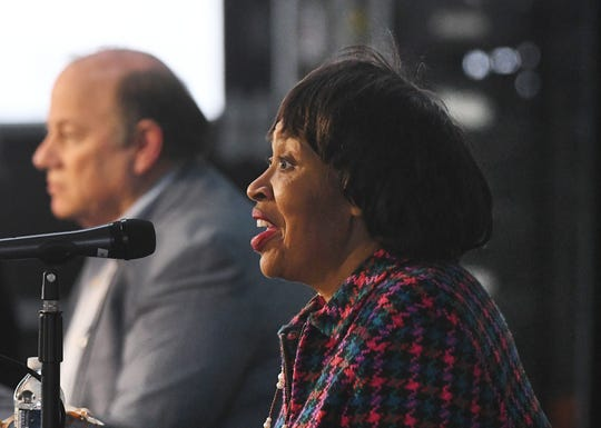 Detroit City Council President Brenda Jones, who tested positive for COVID-19, along with Detroit Mayor Mike Duggan, speak on Detroiters and the coronavirus at a press conference at Shed 5 in Eastern Market in Detroit, Michigan on April 17, 2020.