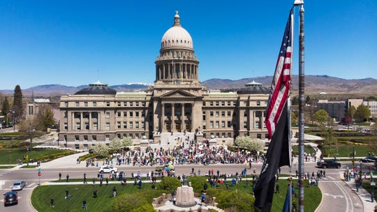 Protesters gather at the Idaho Statehouse on Friday in Boise, Idaho, in defiance of Gov. Brad Little's extension of the statewide stay-at-home order. The crowd pictured here was taken as the rally began; the size of the crowd grew.