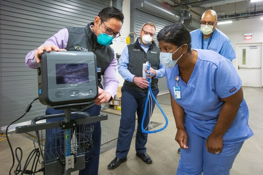 Ventec Life Systems staff show staff at Franciscan Health Olympia Fields Hospital how to operate VOCSN critical care ventilators Friday, April 17, 2020 in Olympia Fields, Illinois, just outside of Chicago. Franciscan received the first shipment of ventilators produced by General Motors and Ventec in response to the COVID-19 pandemic.
