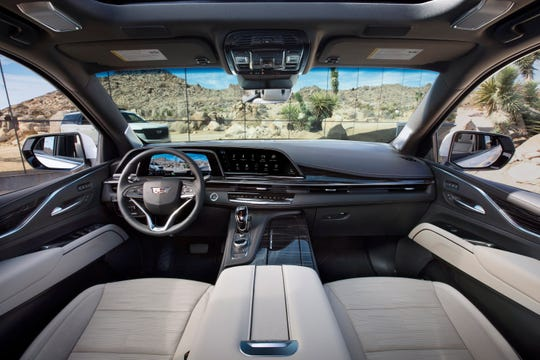 The 2021 Escalade showcases the first curved OLED in the industry with over 38 inches diagonal of total display.