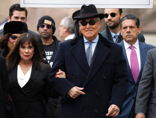 Roger Stone accompanied by his wife Nydia Stone, left, arrives for his sentencing at U.S. District Court in Washington in this Feb. 20, 2020, file photo.
