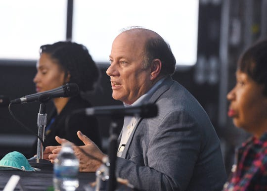 Detroit Mayor Mike Duggan, center, along with Detroit Chief Public Health Officer Denise Fair and Detroit City Council President Brenda Jones, who tested positive for COVID-19 and has since recovered, speak on Detroiters and the coronavirus at a press conference at Shed 5 in Eastern Market in Detroit on April 17, 2020.