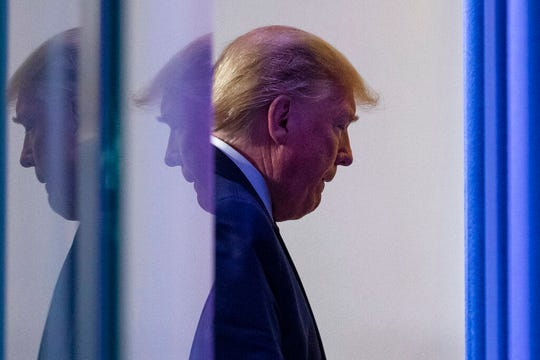 President Donald Trump departs after speaking about the coronavirus in the James Brady Press Briefing Room of the White House, Thursday, April 16, 2020, in Washington.