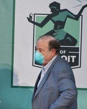 Detroit Mayor Mike Duggan puts on his mask and leaves after a press conference on Detroiters and the coronavirus at Shed 5 in Eastern Market in Detroit, Michigan on April 17, 2020.