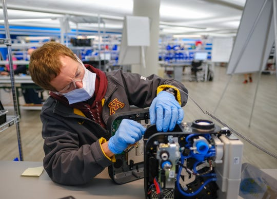 Workers build the first production ventilators at the General Motors Co. manufacturing facility in Kokomo, Indiana, Monday, April 13, 2020. GM and Ventec Life Systems are partnering to produce Ventec critical care ventilators in response to the COVID-19 pandemic.