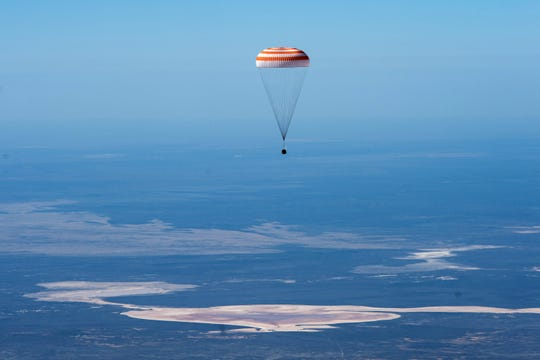 In this handout photo released by Gagarin Cosmonaut Training Centre, the Soyuz MS-15 space capsule carrying International Space Station (ISS) crew members descends beneath a parachute just before landing in a remote area near Dzhezkazgan, Kazakhstan, Friday, April 17, 2020.
