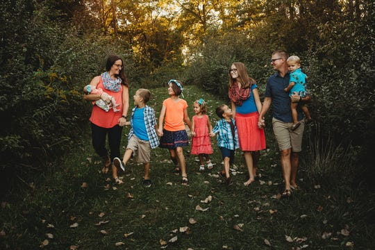The Hudson family has seen its fair share of struggles during the coronavirus pandemic, including finding enough supplies to last while they try and stay home. Pictured are mom Dana, Essie, 1, Mack, 8, Reagan, 12, Ruthie, 5, Tessa, 14, Ben, 6, father Josh and JJ, 3.