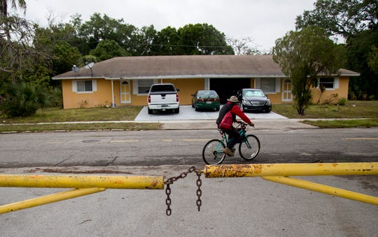 Damon Cobb rides away on his bike after getting a hot meal from Ramona Miller by City of Palms Park in Fort Myers on Thursday, April 16, 2020.