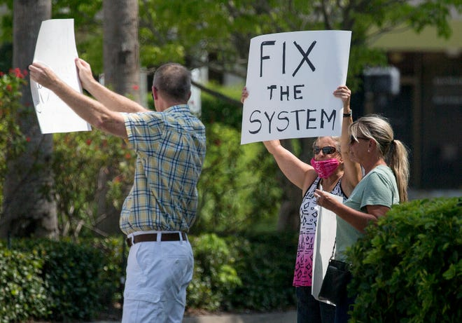 A group of unemployed workers came out to protest the Florida unemployment system on  April 17, 2020, in downtown Naples. Many have now been out of work for weeks and haven't gotten an unemployment check yet.