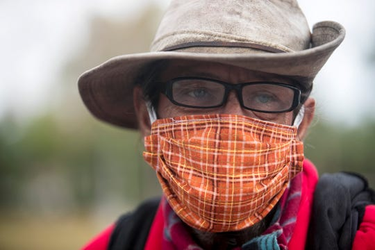 Damon Cobb, who is homeless, was grateful to get a hot meal, a blanket and a mask on Thursday, April 16, 2020, at City of Palms Park in Fort Myers.