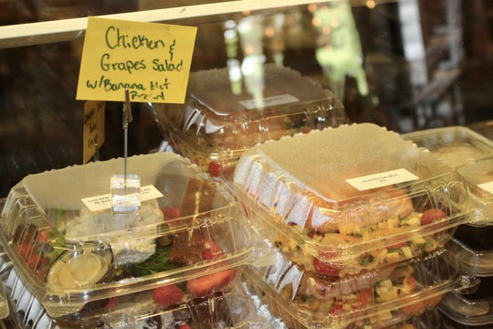 Boxes of salads and sandwiches line the counter at Tony's Off Third in Naples. The restaurant has become a takeout outlet for Ridgway's Bar & Grill and Bayside Seafood Grill, which closed their dining rooms March 20 in accordance with state guidelines.