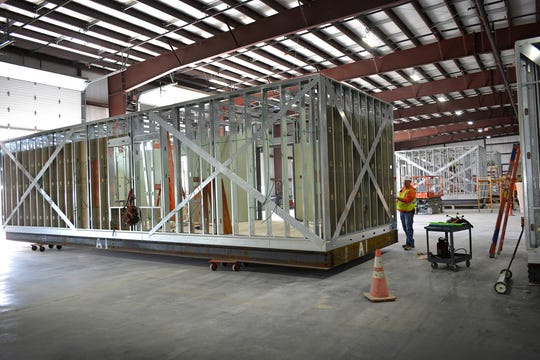 Several mobile critical care units under construction at The Boldt Company's Appleton area prefabrication center. Boldt and health care design firm HGA collaborated to develop the two-bed care units that can be set up indoors or inside and yet are small enough to fit on the back of a semi-truck.