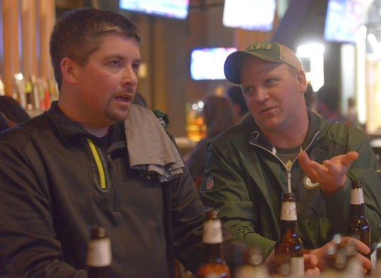 Hutch Ruggles of Eau Claire, right, makes a point to Quincy Devine of Withee on April 26, 2018, at 1919 Kitchen & Tap while waiting for the Green Bay Packers to draft.