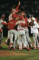 Members of the Cincinnati Reds celebrate on the field of Oakland Coliseum following their 2-1 win over the Oakland Athletics clinching the World Series in 1990. At center is Chris Sabo.